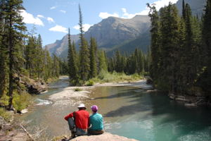 Plan a hike when you travel / Resting from a hike in Glacier N.P. - (c) 2006 Ted Grellner
